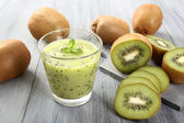 Kiwi smoothie gray background — Stock Photo