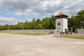 Dachau-electric fence and guard tower — Stock Photo