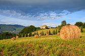 Tuscany presses hay hill — Stock Photo