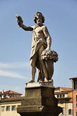 Statue representing the autumn, bridge St. Trinita, Florence 2 — Stock Photo