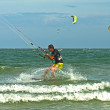 图库照片: Flying a kite surfer