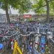 Bicycles parking on the bridge near the Central Station, Amsterdam, Holland - Stock Photo