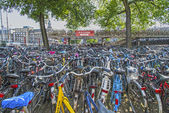 Bicycles parking on the bridge near the Central Station, Amsterdam, Holland — Stock Photo