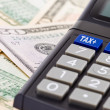 Stock Photo: Tax Calculator and dollar bills
