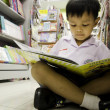 Stock Photo: Child reading book.