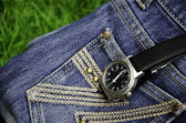 Watch and jeans. — Stock Photo