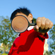 Child with a magnifying glass — Stock Photo #39057351