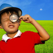 Child with a magnifying glass — Stock Photo #39245011