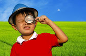Child with a magnifying glass — Stock Photo