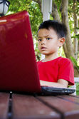 Child with notebook computers — Stock Photo