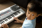 Playing Electone — Stock Photo