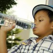 Child holding a water bottle — Stock Photo #47233423