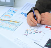 Businessman analyzing investment charts at his workplace — Stock Photo