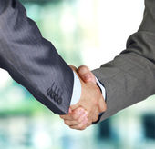 Closeup of a business hand shake between two colleagues — 图库照片