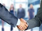 ビジネス ハンドシェイクとビジネス — ストック写真