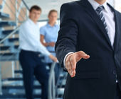 A business man with an open hand ready to seal a deal — Stock Photo