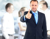 Businessman showing OK sign with his thumb up — Stock Photo