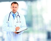 Portrait of doctor in white coat and stethoscope — Stock Photo