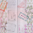 Background of passport stamps closeup — Stock Photo #26384513