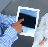 Closeup two modern business people working with digital tablet — Stock Photo