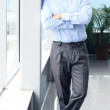 Full length portrait of a mature business man with hands folded — Stock Photo