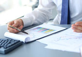Close-up of graphs and charts analyzed by businessman — Stock Photo