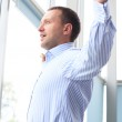 Relaxing businessman looking at the window — Stock Photo