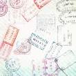 Travel background with different passport stamps — Stock Photo #32696321