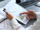Close-up of graphs and charts analyzed by businessman — Stockfoto