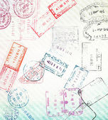 Travel background with different passport stamps — Stock Photo