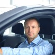 Handsome man in his new car — Stock Photo