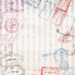 Travel background with different passport stamps — Stock Photo #36236033