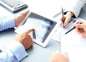 Business adviser analyzing financial figures denoting the progress in the work of the company — Stock Photo