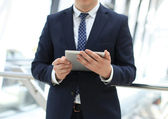 Midsection of businessman using digital tablet in office — Stock Photo