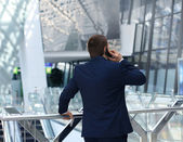 Back view of a business man talking on his smartphone — Stock Photo