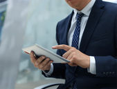 Midsection of businessman using digital tablet in office — Stockfoto