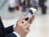 Close up of a business man using mobile smart phone — 图库照片