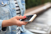 Close up of a woman using mobile smart phone — Stock Photo