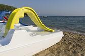 Plastic boat near by the seashore — Stock Photo