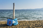 Beach accersories in a package on the seashore — Stock Photo