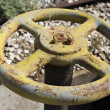 Old yellow wheel valve — Stock Photo #22005991