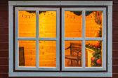 Wooden cabin window on christmas — Stock Photo