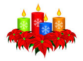 Christmas Candles and Poinsettia Christmas Flowers — Stock Photo