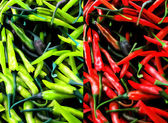 Red and Green Chili Pepers Background. — Photo