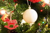 Christmas tree red horse and white ball — Stock Photo