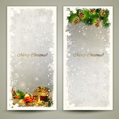Two Christmas greeting cards with gifts and pine cones. — Stock Vector