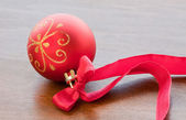 Christmas red ball with ribbon — Stock Photo