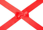 Red satin ribbon with bow — Stock Photo