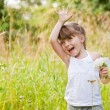 Stock Photo: Little Girl Waving High