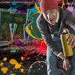 Young graffiti artist with copy space — Stock Photo